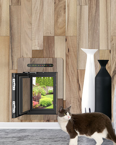 Inside view of a petWALK pet door large installed into wooden wall with custom cover with cat